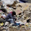 Potters House man on rubbish dump