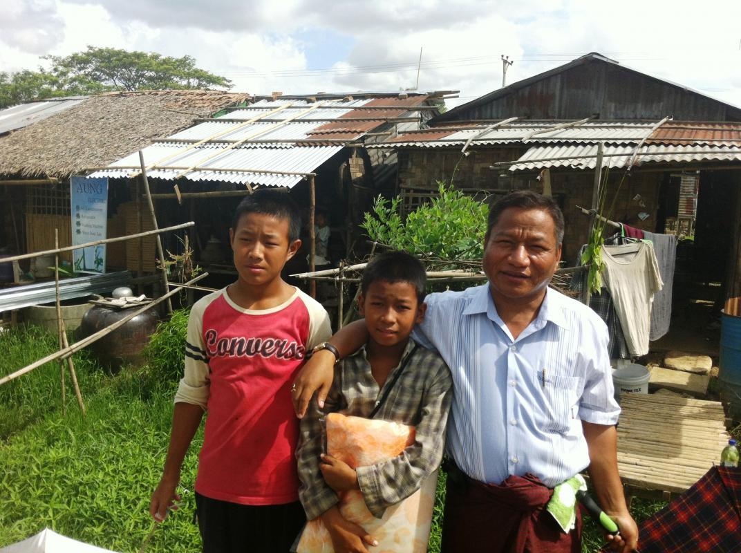 Myanmar family receiving nets
