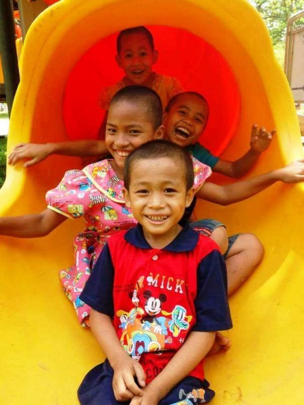 Myanmar children slide
